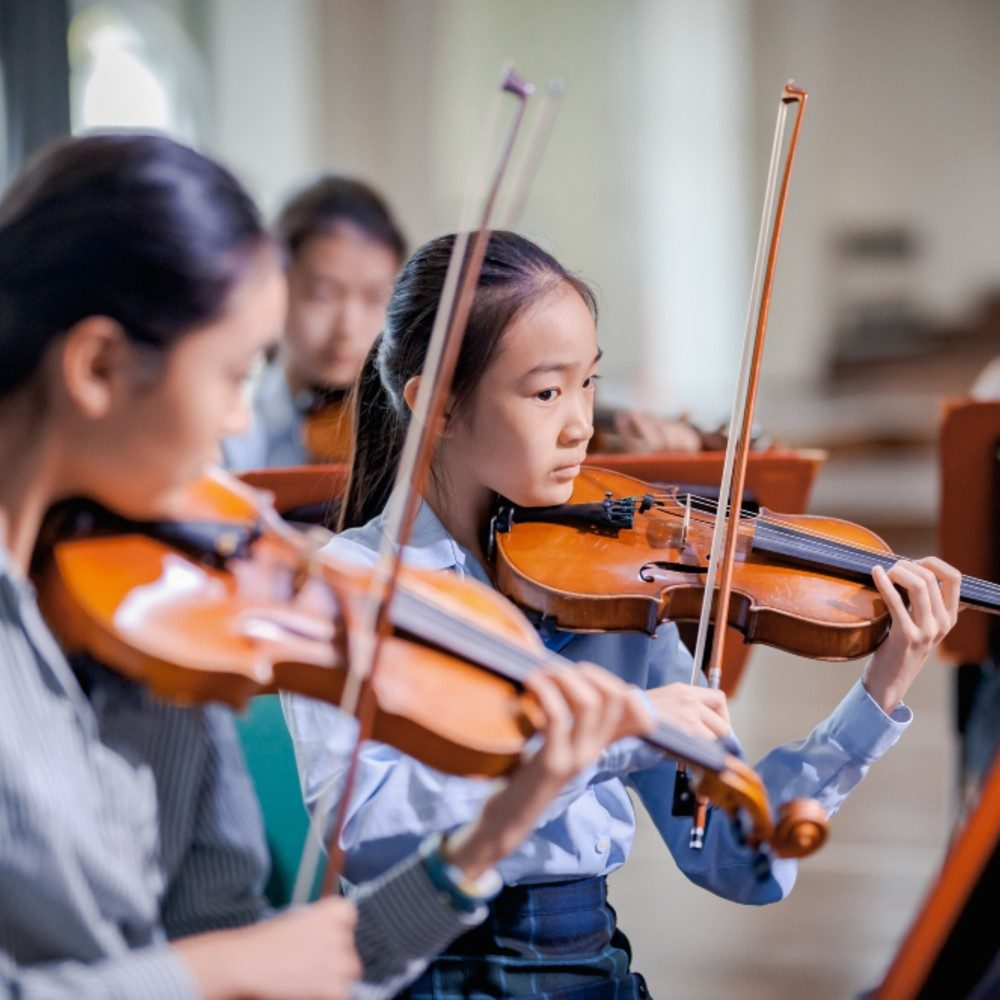 Scholars playing the Violin