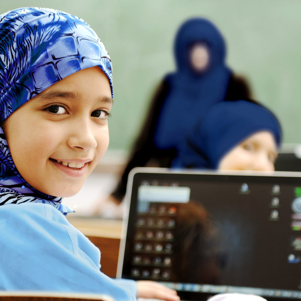 DHM girl learning on laptop